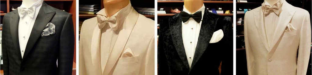 This is a display of both white and black tuxedos and custom summer wedding suits Toronto locals will agree have set the standards in the suiting industry.