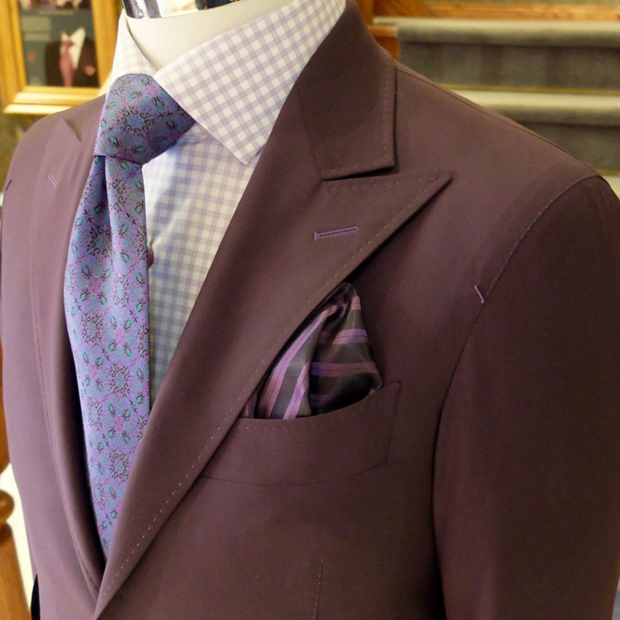 A mauve bespoke suit exudes a calm confidence with class